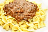 Ground Beef In Brown Gravy Over Pasta Noodles