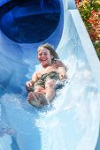 Boy on a tube going down a water slide