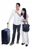 Young Couple With Suitcase