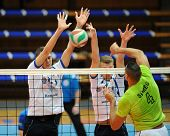 KAPOSVAR, HUNGARY - FEBRUARY 25: Domotor Meszaros (grren 4) in action at a Hungarian National Championship volleyball game Kaposvar (white) vs. Sumeg (green), February 25, 2014 in Kaposvar, Hungary.