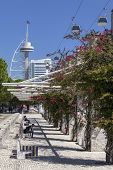 Lisbon, Portugal - August 02, 2013: Passeio Ribeirinho (Waterfront Sidewalk), Vasco da Gama Tower, M