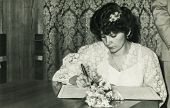 LODZ, POLAND, CIRCA SEVENTIES - Vintage photo of bride signing the marriage contract