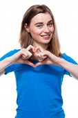Happy Young Woman Making A Heart Gesture