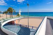 Alicante el Postiguet beach playa with modern pedestrian white bridge at Spain