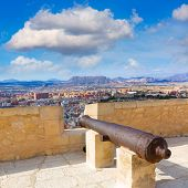Alicante skyline and old canyons of Santa Barbara Castle in Spain