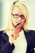 Blond business woman with pen