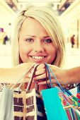 Attractive Young Blond Woman with Shopping Bags