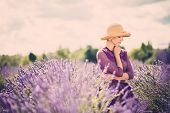 picture of lavender field  - Woman in purple dress and hat in lavender field  - JPG