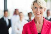 happy senior business woman close up