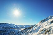 Winter Mountain Landscape Against The Blue Sky. Peaks Of Pirin Mountain