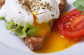 Eggs Benedict With Bread And Tomato Horizontal