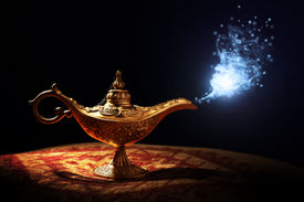 stock photo of pantomime  - Magic lamp from the story of Aladdin with Genie appearing in blue smoke concept for wishing - JPG