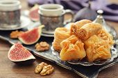 picture of baklava  - Cup of coffee with baklava and metal oriental tray on wooden background - JPG