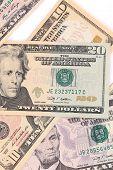 Close up of different dollar bills.