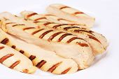Slices of grilled chicken breast.