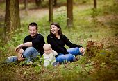 Happy family in forest