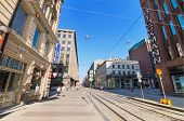 People walking on a sunny day in a typical street at the centre of Helsinki on June 24 2013.