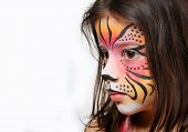 Pretty girl with face painting of a tiger