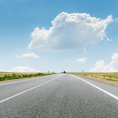 cloud over asphalt road