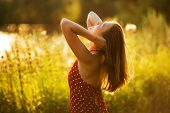 picture of beatitudes  - Happy young woman in the rays of the evening sun - JPG