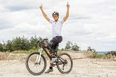 Handicapped Mountain Bike Raising Up Arms