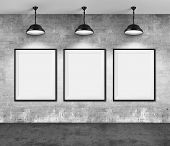 Art gallery. Blank picture frames on grunge wall background.