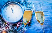 New Year Or Christmas At Midnight With Champagne Flutes With Gold Bubbles Make Cheers On Blue Light