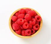 Fresh raspberries in a wooden bowl