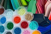 pic of thermoplastics  - several dyed plastic polymer granulates in laboratory - JPG