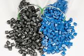 Blue And Black Polymer Pellets In Test Tubes