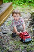 Toddler Playing With A Toy Fire Truck Outside - Series 2