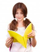 Portrait of cute teen girl reading book isolated on white background, doing homework, back to school