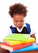 Portrait of little clever boy isolated on white background, cute african schoolboy reading book, bac