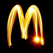 M - Created by light alphabet over black background