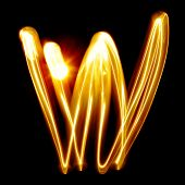 W - Created by light alphabet over black background