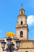 picture of valencia-orange  - Clock and Bells Tower with umbrella decoration on Plaza Mayor in Valencia province Spain - JPG