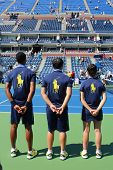Ball persons on tennis court at the Billie Jean King National Tennis Center