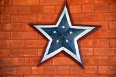 Americana star on red brick wall