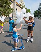Girl Giving Balloons To Boy