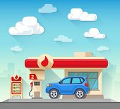 Gas Station And Car In Front Of Cloudy Sky