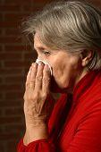 Sick elder woman in red