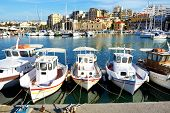 Heraklion, Greece - May 12: The Traditional Greek Fishing Boat Are Near Pier And Tourists On May 12,