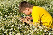Boy Sees Flowers Through Magnifying Glass