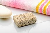 picture of pumice stone  - Pumice volcanic stone with pink and yellow towel and white soap - JPG