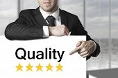 Businessman Pointing On Sign Quality Rating Stars