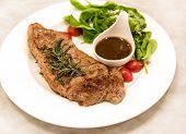Premium Ribeye Steak On A Well Decorated Dish