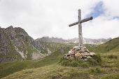 Wooden Cross In Mountains