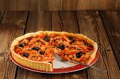 Tomato Tart With Olives And Red Pepper With Space Old Wood Background