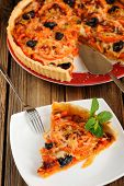 Tomato Tart With Olives On Wooden Background