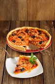Tomato Tart With Olives On Wooden Background With Space